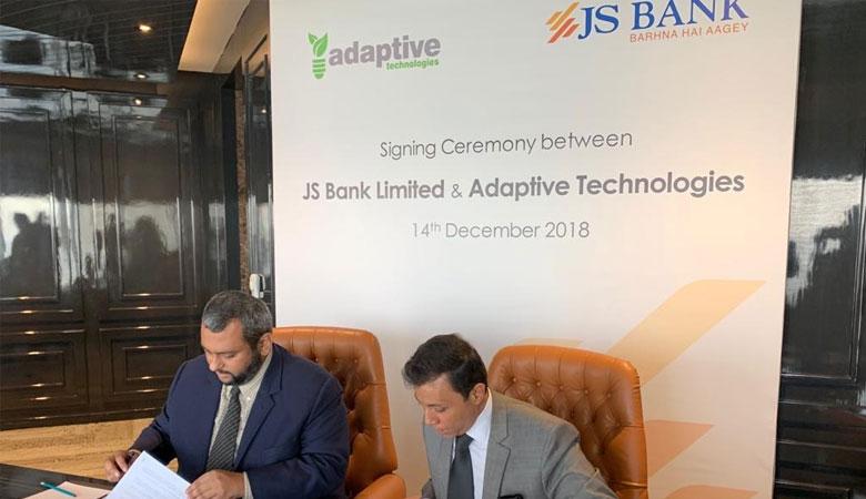 Signing Ceremony between Adaptive Technologies CEO Mr Shaaf  Mehboob and Babbar Wajid, Head of Solar Financing